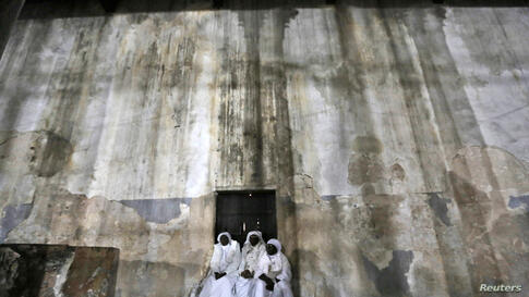 Nigerian pilgrims wait inside the Church of the Nativity, the site revered as the birthplace of Jesus, during Christmas celebrations in the West Bank town of Bethlehem.