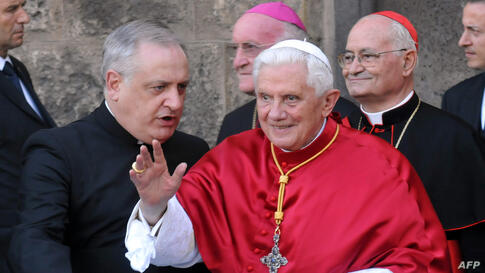 FILE - Pope Benedict XVI delivers his blessing as he leaves Palermo's Cathedral after meeting the city's clergy, in the island of Sicily, Sunday, Oct. 3, 2010. Benedict  outlined his biggest initiative yet Tuesday Oct 12 2010  to try to revive Christianit