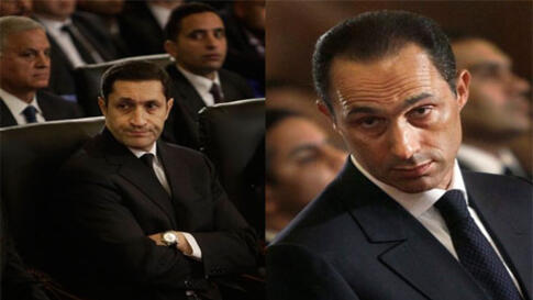 FILE - A Jan. 6, 2011, file photo shows Gamal and Alaa Mubarak, son of Egyptian President Hosni Mubarak, at the Christmas Eve Mass at the Coptic cathedral in Cairo, Egypt. Egyptian authorities took Gamal Mubarek and his brother Alaa into custody Wednesday