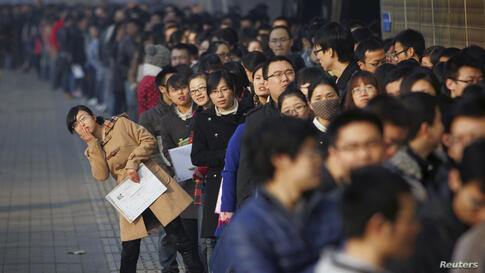 Job seekers line up at a job fair at Tianjin University in China. According to local media, more than 6,000 people rushed to the job fair on Friday for openings from 300 companies.