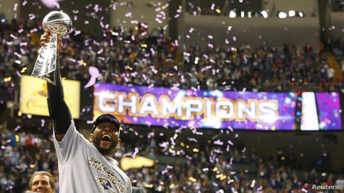 Baltimore Ravens inside linebacker Ray Lewis hoists the Vince Lombardi Trophy as he celebrates victory over the San Francisco 49ers in their NFL Super Bowl XLVII.
