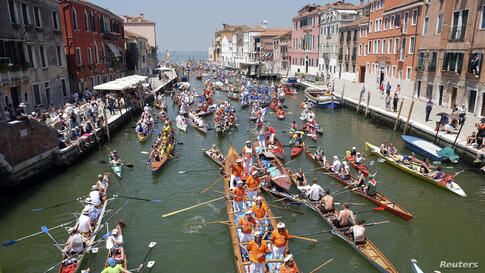 Rowers arrive in the Gran Canal as they take part in the Vogalonga, or Long Row, in the Venice lagoon, Italy.