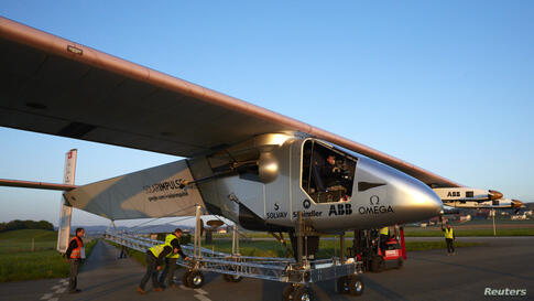 The new Solar Impulse 2 aircraft is pulled out of its base for the first time for tests with solar panels in Payerne, Swizerland. An attempt to fly around the world in stages using only solar energy will be made in 2015.