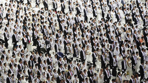 Couples from around the world participate in a mass wedding ceremony at the CheongShim Peace World Center in Gapyeong, South Korea. Some 2,500 South Korean and foreign couples exchanged or reaffirmed marriage vows in the Unification Church's mass weddi...