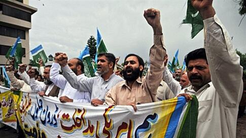 Activists of Jamaat-e-Islami Pakistan shout slogans as they march against the US President Barack Obama for eroding Pakistan's sovereignty with its operation to eliminate Osama bin Laden, in Rawalpindi on May 6, 2011. Hundreds of Pakistanis took to the st