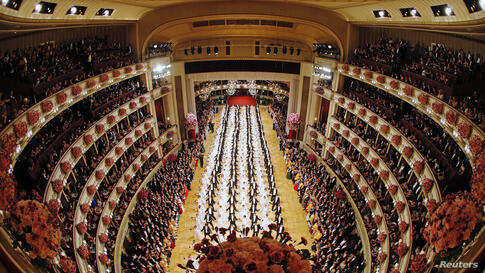 Members of the opening committee perform at the Opera Ball in Vienna, Austria, Feb. 27, 2014. The 18 to 24-year-olds spent weeks rehearsing for a performance that lasts just three or four minutes but had a huge audience at home and abroad.