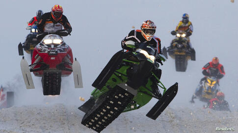 Men's Pro Open riders compete in the Canadian Snowcross Racing Association's (CSRA) Kawartha Cup in Lindsay, Ontario. The snowmobile event is part of CSRA's professional circuit of racing in Ontario and Quebec.