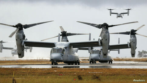 Four Ospreys from the U.S. Navy Ship (USNS) Charles Drew prepare to taxi on the tarmac of Tacloban airport in the aftermath of super Typhoon Haiyan, Philippines.