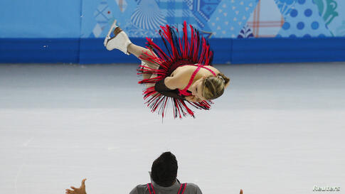 Canada's Paige Lawrence and Rudi Swiegers compete during the Figure Skating Pairs Short Program at the Sochi 2014 Winter Olympics in Russia.