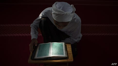 A Malaysian religious student reads the Koran at a school during the Muslim holy fasting month of Ramadan in Hulu Langat, near Kuala Lumpur.