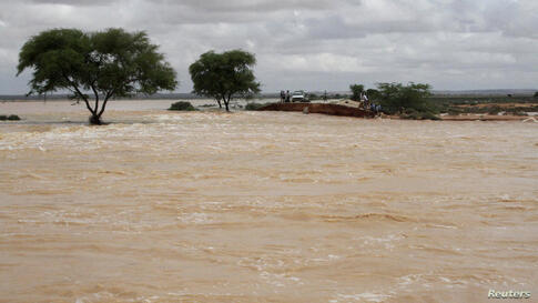 Puntland's officials visit a bridge between Garowe and Eyl that was destroyed by a storm in Somalia's semi-autonomous Puntland region near Bosasso, Nov. 12, 2013. The death toll from a tropical cyclone that hit Puntland on the weekend has risen to 140 ...