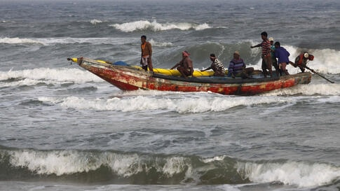 Indian fishermen return to shore after a cyclone alert was sounded in the coastal area of Gopalpur, in the eastern Indian state of Orissa.