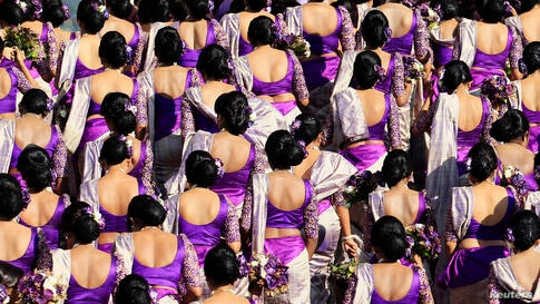 Bridesmaids pose for a photo during a wedding ceremony for Sri Lankan couple Nisansala and Nalin as they break the Guinness record for a wedding with the most bridesmaids for a bride in Negombo. Up to 126 bridesmaids, 25 best men, 20 page boys and 23 f...