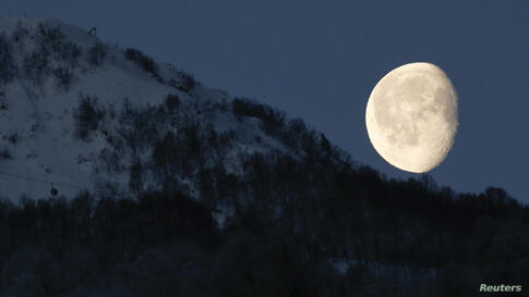 The moon is seen above the mountains in Rosa Khutor during the 2014 Sochi Winter Olympics in Russia.