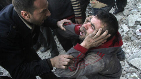 A man reacts after what activists said was an air raid by forces loyal to Syrian President Bashar Al-Assad in Aleppo's al-Marja district. More than 300 people have been killed in a week of air raids on the northern city of Aleppo and nearby towns, a mo...