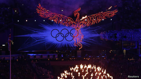A flaming phoenix flies above the Olympic flame during the closing ceremony of the London 2012 Olympic Games at the Olympic Stadium August 12, 2012.