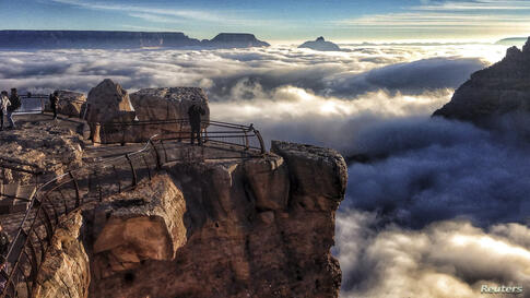 A rare total cloud inversion at Mather Point on the South Rim of the Grand Canyon National Park in Grand Canyon, Arizona, USA. Cloud inversions are formed through the interaction of warm and cold air masses.