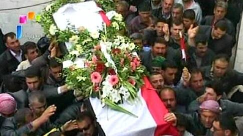 """Syrian state television video footage shows mourners carrying a coffin during the funeral of two members of the security forces after they were allegedly killed by """"armed groups"""", in Hama, north of Damascus, on April 10, 2011"""