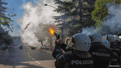Police fire teargas at opponents of same-sex rights in Podgorica. Some 150 supporters of same-sex rights, guarded by almost 2,000 policemen, staged the first Pride March in the Montenegrin capital and hailed it as a herald of better times, Oct. 20, 2013.