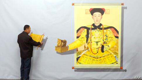 A man interacts with a 3D painting during a Magic Art Special exhibition at a gallery in Beijing, China. In the 3D painting exihibition, visitors are encouraged to interact with the lifelike images by touching or other creative action into the artworks.