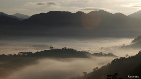 Fog surrounds the mountains in Goncalves, in the state of Minas Gerais in southwestern Brazil.