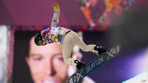 Shaun White of the U.S. performs a jump near a picture of himself during the men's snowboard halfpipe qualification round at theRosa Khutor Extreme Park, Krasnaya Polyana, Russia,Feb. 11, 2014.