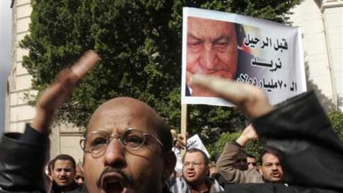 An Egyptian lawyer shouts anti-Mubarak slogans as lawyers streamed into Cairo's Tahrir Square, Thursday, Feb. 10, 2011. Labor unrest across the country gave powerful momentum to Egypt's wave of anti-government protests. With its efforts to manage the cris