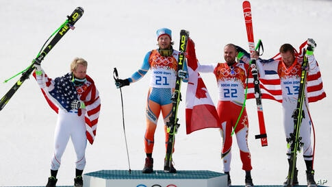 Men's super-G medalists from left, United States' Andrew Weibrecht (silver), Norway's Kjetil Jansrud (gold), Canada's Jan Hudec (bronze) and United States' Bode Miller (bronze) pose for photographers on the podium, Krasnaya Polyana, Russia, Feb. 16, 20...