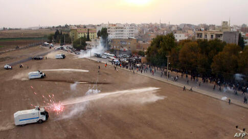 Turkish riot police use tear gas and water cannon to disperse Turkish-Kurd demonstrating on the Turkish side as Syrian Kurds gather on the other side of the border in Mardin's Nusaybin district, Turkey. Kurdish people protest against the construction b...