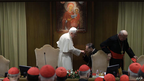Pope Benedict XVI is greeted as he arrives to meet cardinals he summoned for a day of reflection at the Vatican, Friday, Nov. 19, 2010, the day before a ceremony to create 24 new cardinals. The top agenda, religious freedom, grew remarkably timely given C