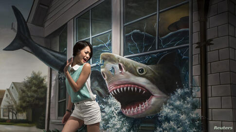 A woman poses for a photograph in front of a 3D painting at Hong Kong 3D Museum.