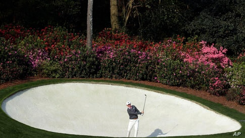 Brandt Snedeker hits out of a bunker on the 13th hole during a practice round for the Masters golf tournament in Augusta, Georgia, USA.
