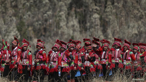 Ethnic Yi women are seen on their way to a dragon worship ceremony in Shiping county, Yunnan province. The dragon worship ceremony is held every 12 years to pray for good fortune and harvest.