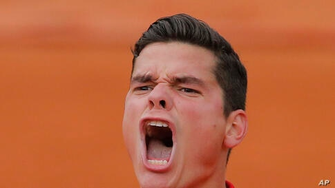 Canada's Milos Raonic celebrates winning the fourth round match of the French Open tennis tournament against Spain's Marcel Granollers at the Roland Garros stadium, in Paris, France. Raonic won in three sets 6-3, 6-3, 6-3.