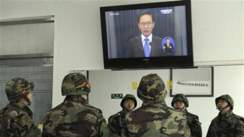 South Korean marines watch a live television broadcast of President Lee Myung-bak's speech, on Yeonpyeong Island, South Korea, Monday, Nov. 29, 2010. Lee took responsibility for failing to protect his citizens from a deadly North Korean artillery attack l