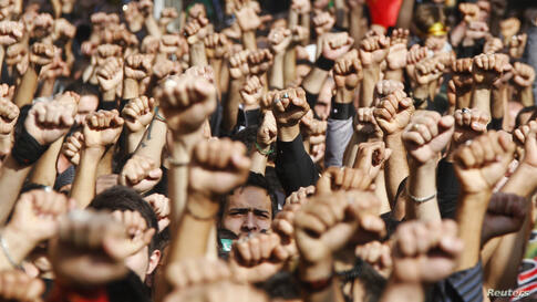 Lebanese Hezbollah supporters march during a religious procession to mark Ashura in Beirut's suburbs.