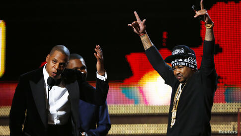 """Jay-Z (L), Frank Ocean (C), and The-Dream accept the Grammy for best rap/sung collaboration for """"No Church in the Wild"""" at the 55th annual Grammy Awards in Los Angeles, California, Feb. 10, 2013."""