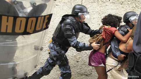 Police officers clash with supporters of the native Indian community during a protest outside the Indian museum in Rio de Janeiro, Brazil. Police arrested more than 20 indigenous people who occupied the abandoned museum as a protest against its demolit...