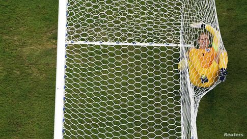 England's goalkeeper Joe Hart rolls inside the goalpost after Italy's Mario Balotelli (not pictured) scored during their 2014 World Cup Group D soccer match at the Amazonia arena in Manaus, Brazil, June 14, 2014.