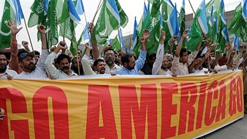 Activists of Jamaat-e-Islami Pakistan shout slogans as they march against the US President Barack Obama for eroding Pakistan's sovereignty with its operation to eliminate Osama bin Laden, in Lahore on May 6, 2011. Hundreds of Pakistanis took to the street