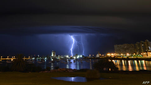 Lightning strikes behind the Port of Buceo during a thunderstorm early on Sunday morning in Montevideo, Uruguay.