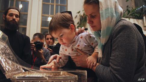 Orthodox Christians touch the shrine with the Gifts of the Magi relic displayed at a church in Minsk, Belarus.