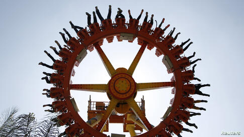 Palestinians enjoy a ride at an amusement park on the second day of the Muslim holiday of Eid al-Adha in the West Bank town of Tulkarm.