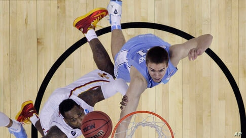 Iowa State's DeAndre Kane (l) makes the winning shot over North Carolina's Jackson Simmons (r), in the final seconds of the second half of a third-round game in the NCAA college basketball tournament in San Antonio. Iowa State won 85-83, March 23, 2014.