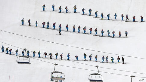 Slippers prepare the course ahead of the slalom portion of the men's supercombined at the Sochi 2014 Winter Olympics in Krasnaya Polyana, Russia.