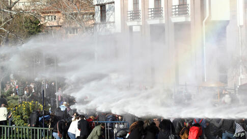 Turkish riot police use water cannon to disperse demonstrators protesting outside the Supreme Electoral Council (YSK) in Ankara against local election results which the Islamic-rooted party of Premier Recep Tayyip Erdogan claimed sweeping victories.