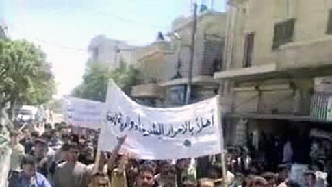 "A video still taken from YouTube shows Syrians demonstrating in Kofr Bel on May 6, 2011, a ""Day of Defiance"" in which thousands rallied as  President Bashar al-Assad's regime deployed tanks in at least three centers of an uprising against his rule"