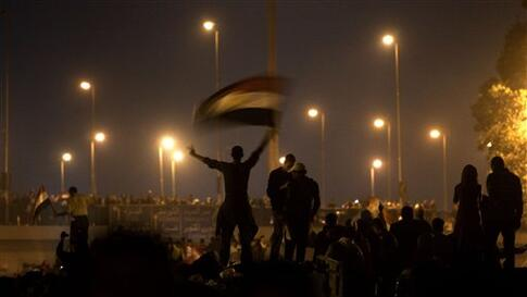 Anti-government protesters celebrate in the street in downtown Cairo, Egypt , Egypt Friday, Feb. 11, 2011. Fireworks burst over Tahrir Square and Egypt exploded with joy and tears of relief after pro-democracy protesters brought down President Hosni Mubar