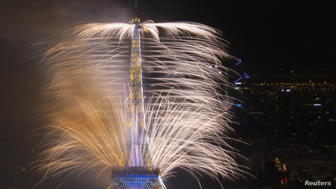 "Fireworks light the sky near the Eiffel Tower in a show called ""Guerre et Paix"" (War and Peace) as part of events to mark the centenary of the First World War and to end the traditional Bastille Day celebrations in Paris, July 14, 2014."