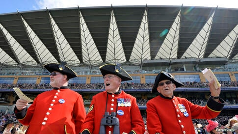 Chelsea Pensioners react on the fourth day of the Ascot horse racing festival at Ascot in southern England.